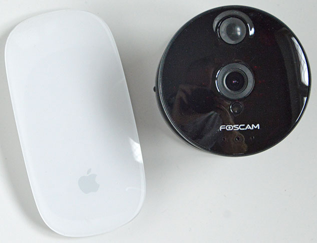 Foscam C1 with Magic Mouse for size comparison